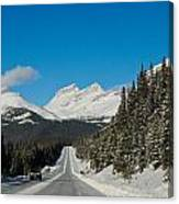 Highway In Winter Through Mountains Canvas Print