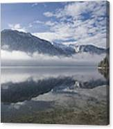 mist burning off Lake Bohinj Canvas Print