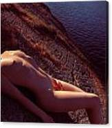 Nude Woman Lying On Rocks By The Water Canvas Print