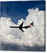 Passenger Jet And Clouds Canvas Print