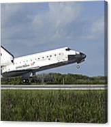 Space Shuttle Discovery Lands On Runway Canvas Print