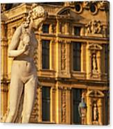 Statue Below Musee Du Louvre Canvas Print