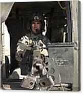 A Uh-60 Black Hawk Door Gunner Manning Canvas Print