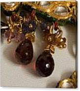 3 Hanging Semi-precious Stones Attached To A Green And Gold Necklace Canvas Print