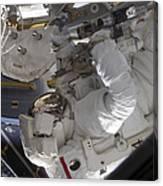 Astronaut Working On The International Canvas Print