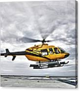 A Bell 407 Utility Helicopter Prepares Canvas Print