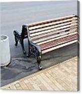 A Bench To Rest In A Public City Park Canvas Print