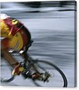 A Bicyclist Speeds Past In A Race Canvas Print