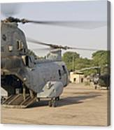A Ch-46 Sea Knight And Mi-8 Helicopter Canvas Print