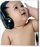 A Chubby Little Girl Listen To Music With Headphones Canvas Print