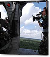 A Cinematographer Videotapes A Soldier Canvas Print