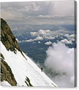 A Climber Walks Along A Steep Slope Canvas Print
