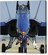 A Crew Chief Sprints Ahead Of A Blue Canvas Print