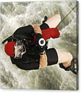 A Diver Is Hoisted Aboard An Sh-60f Canvas Print