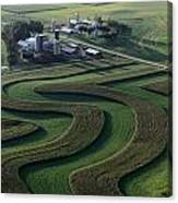 A Farm With Curved And Twisting Fields Canvas Print