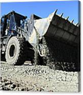 A Front End Loader Raising A Road Bed Canvas Print