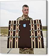 A German Soldier Holds A Display Canvas Print