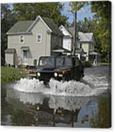 A Humvee Drives Through The Floodwaters Canvas Print