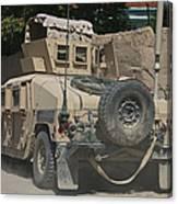 A Humvee Patrols The Streets Of Kunduz Canvas Print