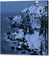 A Lighthouse Atop Snow-covered Cliffs Canvas Print