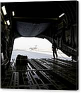 A Loadmaster Guides The Pilot Of A C-17 Canvas Print