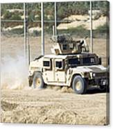 A M1114 Humvee Patrols The Perimeter Canvas Print