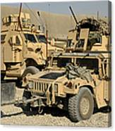 A M1114 Humvee Sits Parked In Front Canvas Print