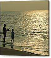 A Man And A Young Boy Fish In The Surf Canvas Print