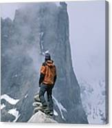 A Man Stands On A Cliff Watching Canvas Print