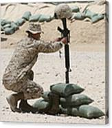 A Marine Hangs Dog Tags On The Rifle Canvas Print