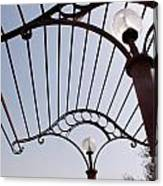 A Metal Structure That Is Part Of The Lamp Shade Arrangement In A Garden Canvas Print