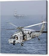 A Mh-60s Knighthawk Conducts A Vertical Canvas Print
