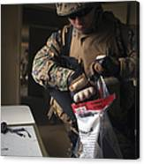 A Military Policeman Collects Materials Canvas Print