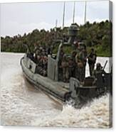 A Navy Riverine Patrol Boat Conducts Canvas Print