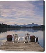 A Pair Of Adirondack Chairs On A Dock Canvas Print