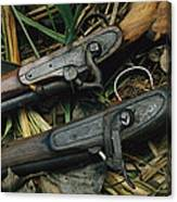 A Pair Of Old Flint-type Rifles Lying Canvas Print