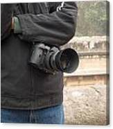 A Photographer With His Digital Camera On Location At A Historical Monument Canvas Print