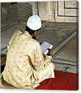 A Pious Devotee Reading The Quran Inside The Jama Masjid In Delhi Canvas Print