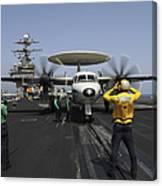 A Plane Director Guides An E-2c Hawkeye Canvas Print