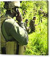 A Riverine Soldier Radios In Mock Canvas Print