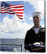 A Sailor Carries The National Ensign Canvas Print