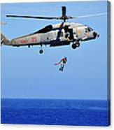 A Search And Rescue Swimmer Is Lowered Canvas Print