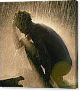 A Silhouetted Man Cooling Off In Water Canvas Print