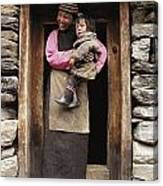 A Smiling Bhutanese Woman And Child Canvas Print