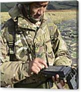 A Soldier Inputs The Firing Data Canvas Print