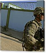 A Soldier Patrols The Streets Of Qalat Canvas Print