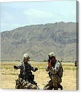 A Soldier Prepares A Drag Line While An Canvas Print