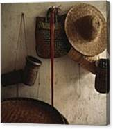 A Straw Hat, Straw Baskets And A Belt Canvas Print