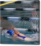 A Swimmer Races Through The Water Canvas Print