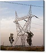 A Transmission Tower Carrying Electric Lines In The Countryside Canvas Print